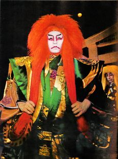 kabuki actor with long red wig