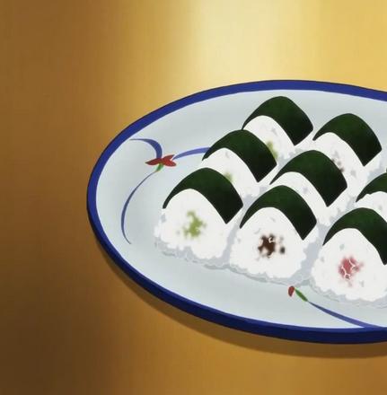 onigiri on plate with nori on top